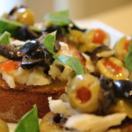 Green Olive, Goat Cheese & Basil Crostini