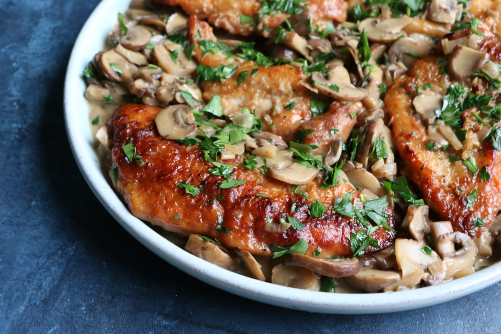 Chicken Marsala! Delicious, so flavorful and easy to make! You will love this thick and creamy mushroom sauce! Learn how to make this restaurant favorite in your very own kitchen!