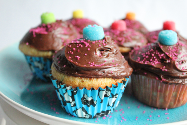Delicious vanilla cupcakes with rich chocolate frosting, topped with colorful gum drops! Inspired by one of my fave candy shops in Manhattan Beach, CA. #cupcakes