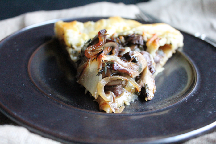 Beautiful Mushroom, Onion and Thyme Galette! I love the gorgeous rustic look of a freeform galette! Filled with mushrooms, thyme and shredded mozzarella cheese, this is rewarding to make and eat!