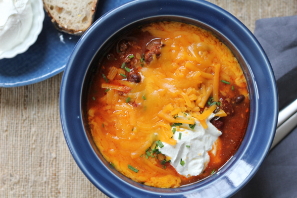 Slow Cooker Cheeseburger Chili! Ooeey, gooey cheese and big chunks of lean ground beef. Your slow cooker does all the work!