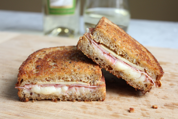 Apple Prosciutto and Gruyere Grilled Cheese on cuting board