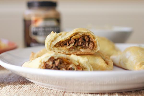Baked Empanadas, three ways! Traditional ground beef, bratwurst & sauerkraut and mac and cheese empanadas!! Serve these at your next dinner party or brunch!