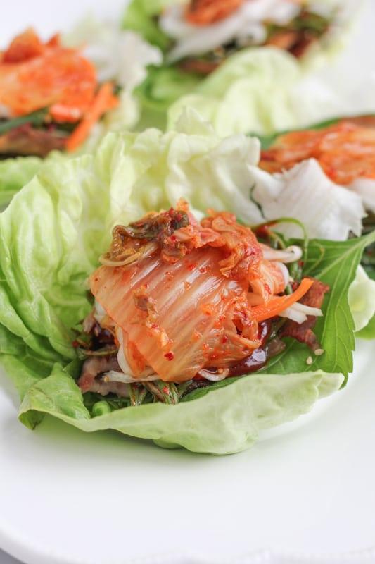Pork Belly Lettuce Wraps on a white plate.