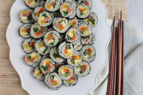 Korean Kimbap! Rice rolls made from steamed white rice and other ingredients, such as vegetables and beef, rolled in dried seaweed sheets! It's like Korean sushi!