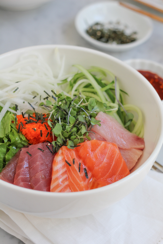 Very similar to Japanese sashimi donburi, this Korean Mixed Rice with Sashimi is the same kind of dish but uses a slightly sweet and spicy sauce, using gochujang. You've got to try this! #sushi #sashimi
