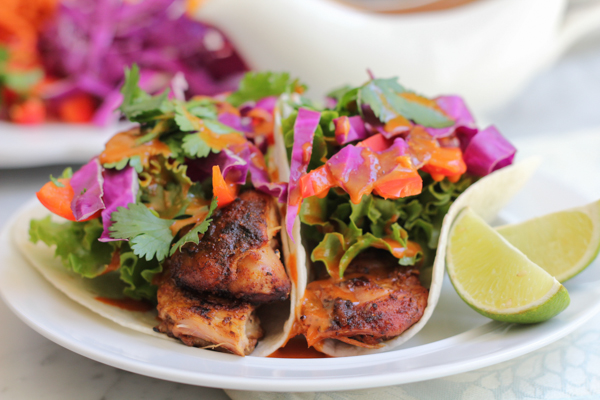 Delicious Chicken Satay Tacos with Spicy Peanut Sauce for #SundaySupper!! Grilled to perfection and topped with a sweet and spicy Korean gochujang sauce, you need to try this recipe!
