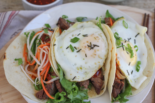 Bibimbap Tacos!! Tacos inspired by one of my favorite Korean food dishes. . minus the rice, filled with everything you'd expect from bibimbap and topped with a fried egg!