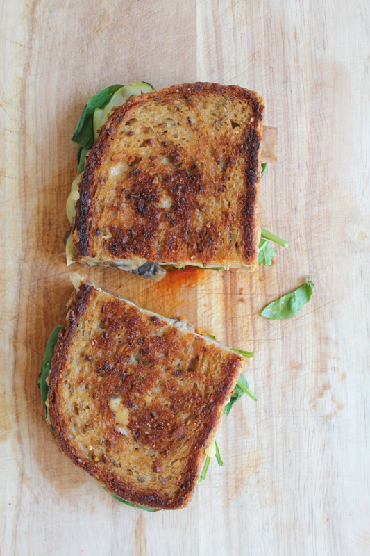 The Ultimate Grilled Veggie Sandwich packed with zucchini, baby spinach and portobello mushrooms and a sweet and spicy gochujang sauce. You'll never want another sandwich again.