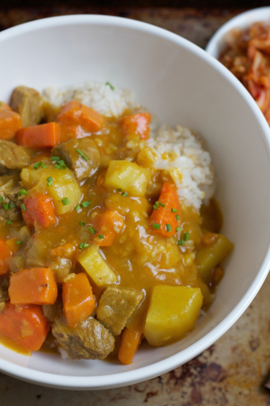 Korean Curry Rice! Filled with chunks of potatoes, carrots, beef and sweet potatoes, this hearty bowl of curry will hit the spot! #koreanfood #curry