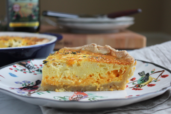 Wow family and friends with this gorgeous and delicious Apple, Cheddar, and Thyme Quiche with Olive Oil Pastry crust.