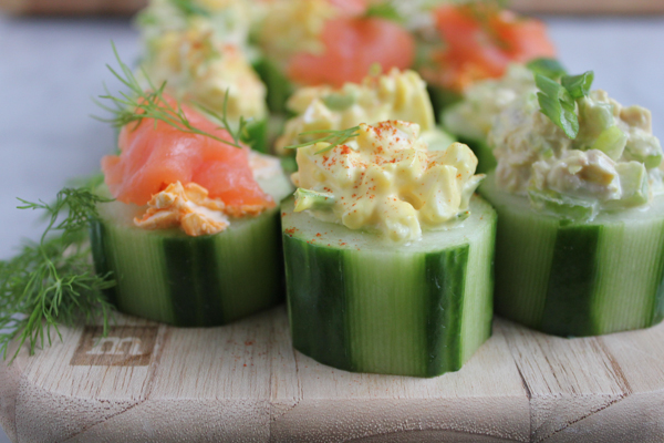 Quick and easy cucumber bites. . Three ways!! Smoked salmon with sriracha cream cheese, egg salad and tuna salad! Great party appetizer!