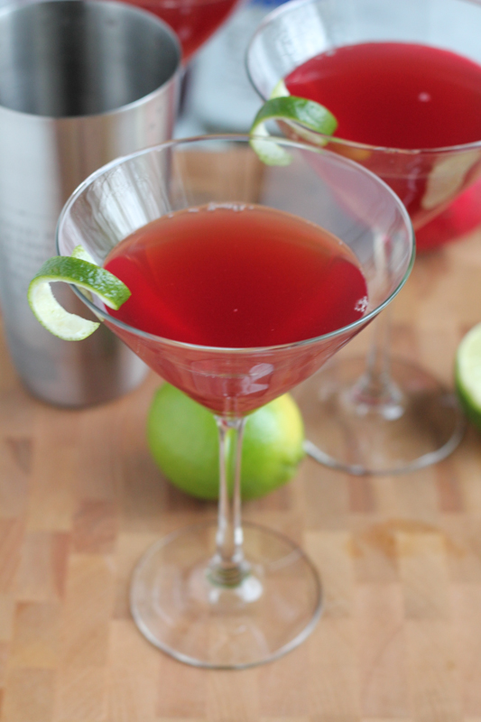 Ring in the New Year with this delicious, easy-to-follow Pomegranate Cosmopolitan recipe. This might become your favorite cocktail. #cocktail #cocktailrecipe #pomcosmos #newyearseve