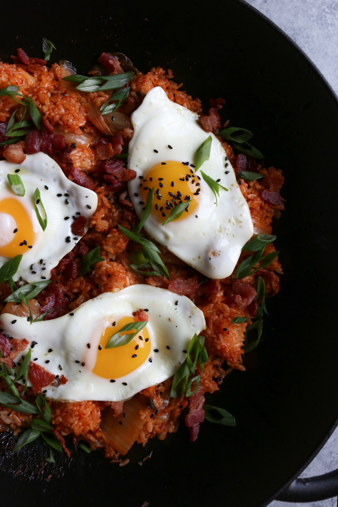 Korean Kimchi Fried Rice Bowl (Kimchee Bokkeum Bap)!! Hot and spicy and filled with bacon bits, kimchi and topped with a fried egg. This is one of my favorite meals to eat! You've got to try this!