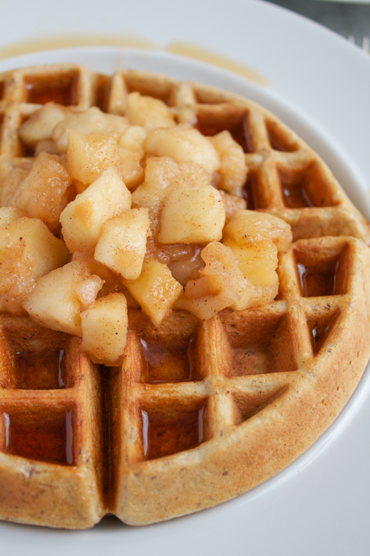 Whole Wheat Hazelnut Waffles with Cinnamon Sautéed Apples. Homemade waffles using whole-wheat pastry flour and hazelnut flour. Your breakfast or holiday brunch never looked so good. #breakfast #brunch #holidays #waffles