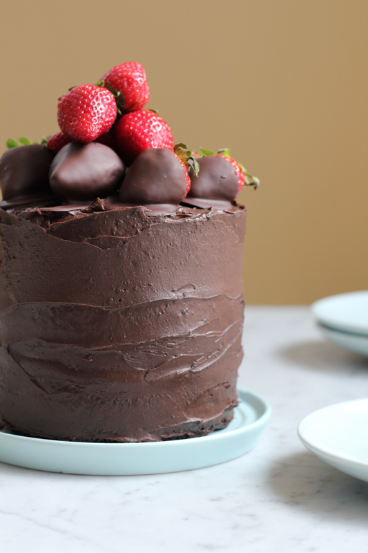 3 Layer Rich Chocolate Cake With Dark Frosting And Covered Strawberries
