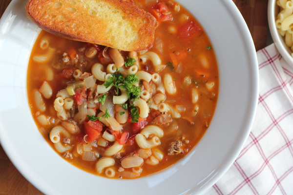 Italian Pasta and Bean Soup—Pasta e Fagioli! Perfected by America's Test Kitchen, this version has great depth of flavor, texture and takes half the time. #soup #comfortfood #pastaefagioli