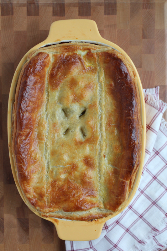 With layers and layers of flaky crust and packed with sweet potatoes, kale and leeks, celebrate winter's bounty with this fabulous Seasonal Vegetarian Pot Pie. #comfortfood #potpie #vegetarian