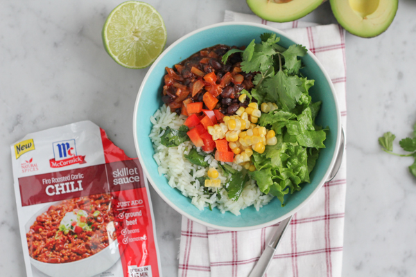 Fire Roasted Garlic Vegetarian Chili served over cilantro lime rice and topped with a ton of fresh veggies. Have dinner on the table in about 30 minutes! #weeknightdinner #SundaySupper #McSkilletSauce #quickrecipe