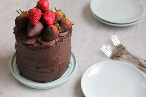 3-layer, rich, chocolate cake with dark chocolate frosting and chocolate covered strawberries on top. This is seriously the best chocolate cake. Ever. #valentinesday #cake #chocolatecake
