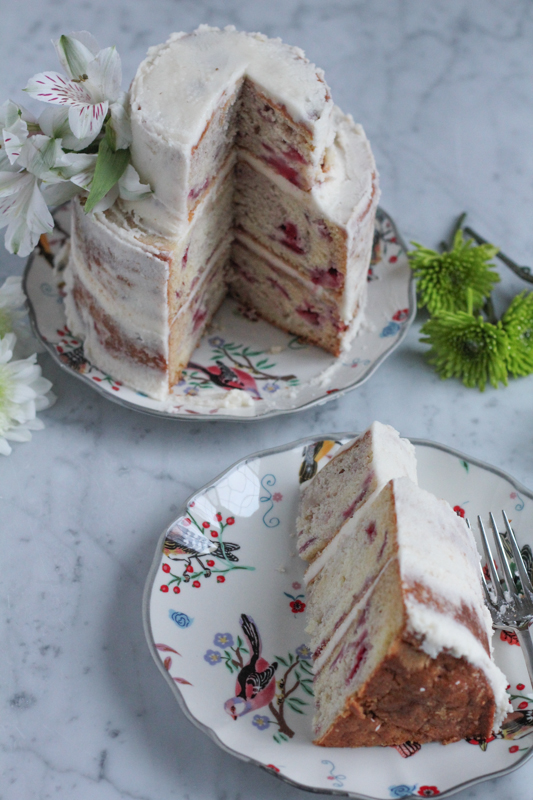 Say I love you this Valentine's Day with a strawberry cake! This cake is perfectly moist and sweet and filled with fresh strawberries! #VanillaWeek #cake #ValentinesDay