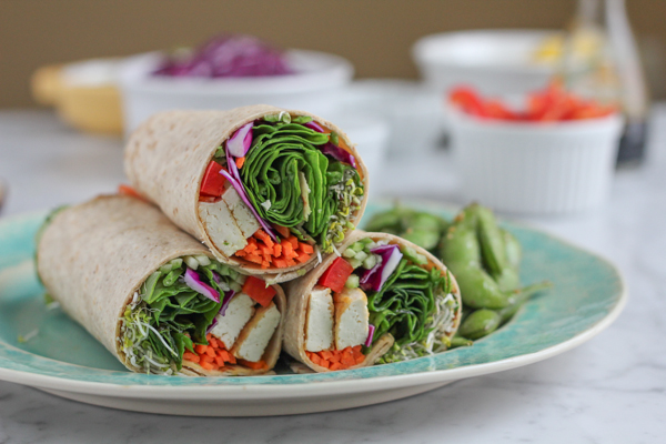 Packed with protein-rich tofu and a ton of veggies, this Tofu Spinach Power Wrap is just the thing you need to eat healthier. So, go ahead and eat the entire thing! There's nothing here to feel guilty about. #healthy #wraps #vegetarian #asianfood