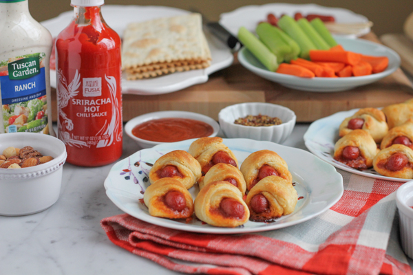 Pigs in a blanket with a kick! You've got to try these Sriracha Honey Lime Pigs in a blanket!! So delicious & flavorful, you need these for Super Bowl Sunday! #gamedayfood #superbowlfood #appetizer