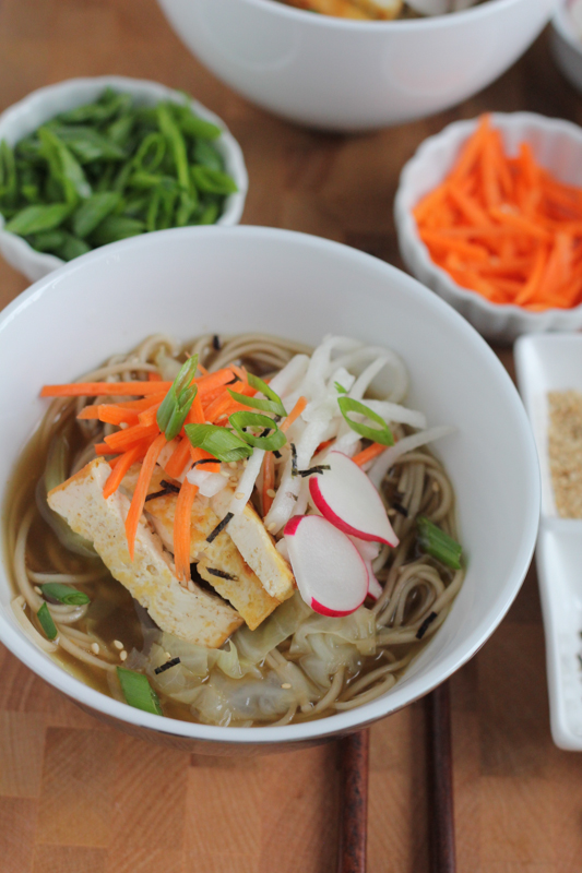 Soba Noodle Broth Bowls! So delicious and easy to make! Filled with cabbage, buckwheat noodles, a light and flavorful broth and veggies for garnish, you've got to try this! #sundaysupper #asianfood