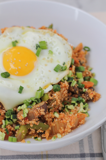 Packed with flavor, veggies, kimchi and some heat, this Korean Style Cauliflower Rice does not disappoint! Cauliflower rice lovers, you need to try this!