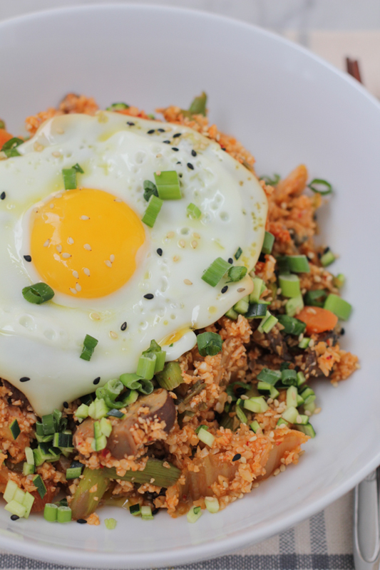 Packed with big flavors, veggies, kimchi and some heat, this Korean Style Cauliflower Rice does not disappoint! Cauliflower rice lovers, you need to try this! #cauliflowerrice