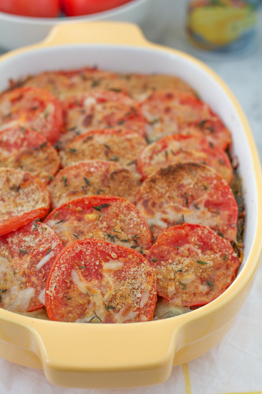 Impress your friends and family with this Scalloped Potato Casserole at your next party or holiday brunch! Layers of thinly sliced potatoes covered with pesto and then topped with tomatoes and a light bread crumb topping, this casserole will be the star at your table! #Easter #brunch