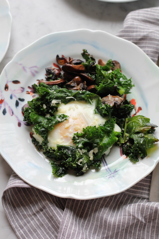 Fried eggs with sautéed kale and mushrooms. So flavorful and ...