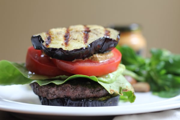Grilled Eggplant Bun Burger on a plate.