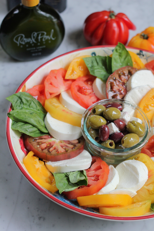 Simple caprese salad with fresh heirloom tomatoes and mozzarella. So fresh, so good and so easy to make!
