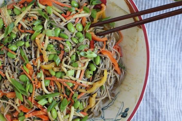 A bowl of Light Asian Noodle Salad with chopsticks.