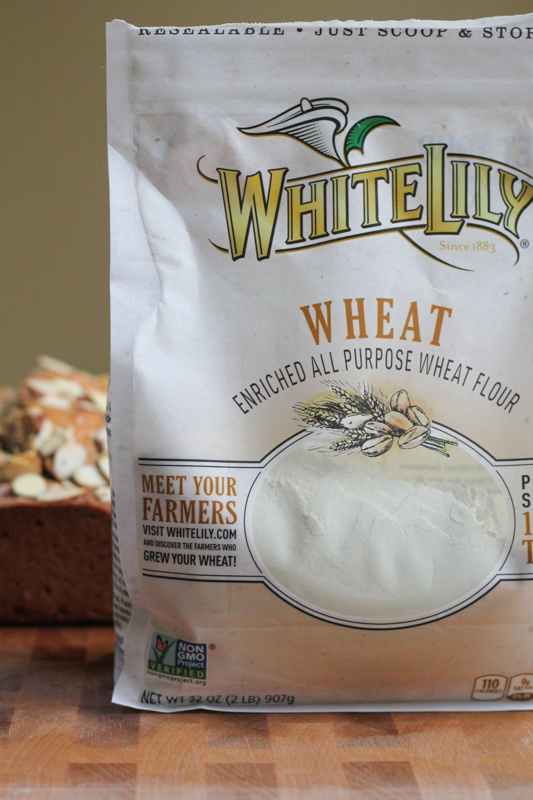 Slightly sweet and packed with flavor and tons of almonds, this Almond Wheat Bread is amazing! Slather on some butter and honey or some of your favorite jam. Delicious! #whitelilyflour #ad