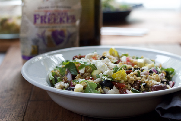 Bright, fresh and flavorful, you've got to try this Mediterranean Freekeh Salad. Organic Cracked Freekeh cooks up in just 20 minutes for an easy, quick whole grain addition to your dinner table! #spon