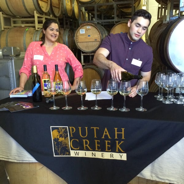 Wine being poured for a California winery tasting.