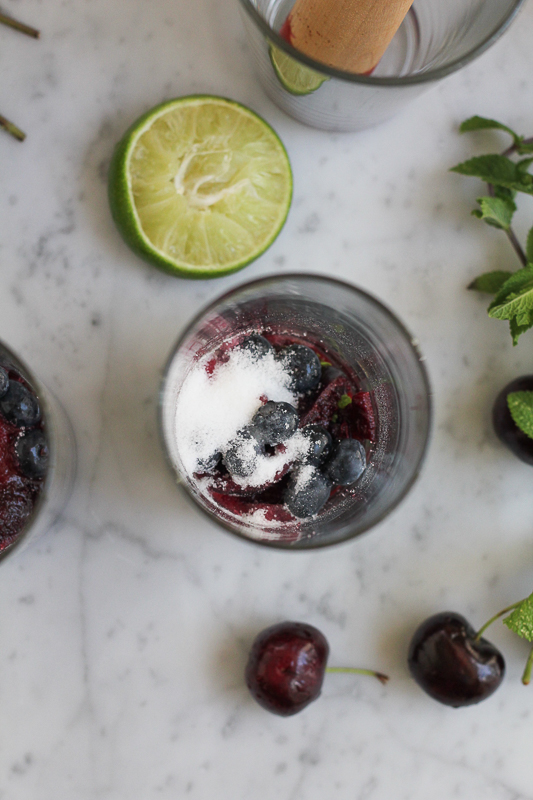 Channel your inner mixologist and try this refreshing and delicious Blueberry Cherry Mojito! Sweetened with fresh blueberries and cherries, this mojito is amazing! #spon