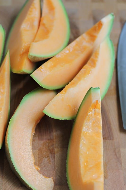 Sliced cantaloupe for Simple Cantaloupe Salad.