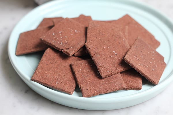 A plate of brownie thins crackers.
