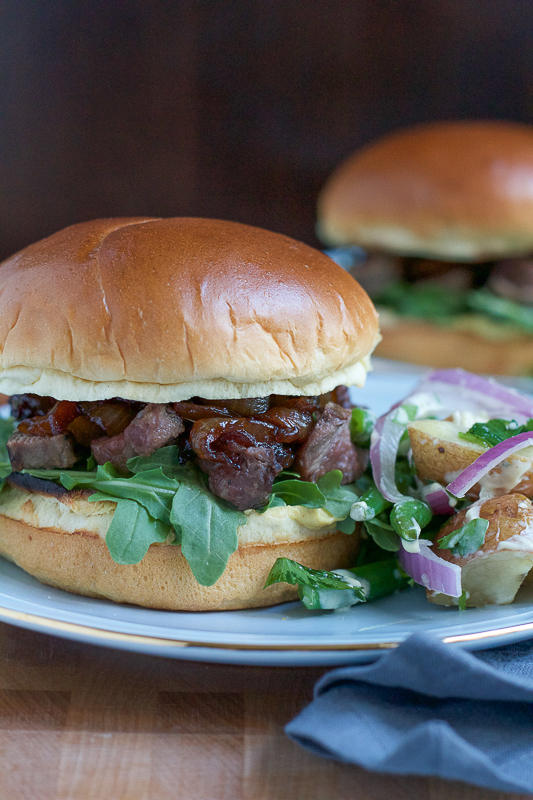 Filet mignon burger with caramelized onions, fresh arugula, dijon mustard on a toasted brioche bun. It doesn't get any better than this. #ad