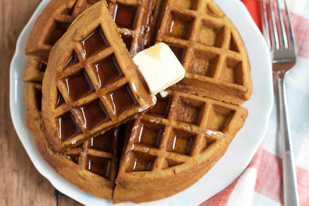 Gingerbread Pumpkin Waffles! Richly spiced with cloves, nutmeg, cinnamon and ginger, these waffles get an additional boost of flavor from finely diced candied ginger. Don't miss these waffles! #ad
