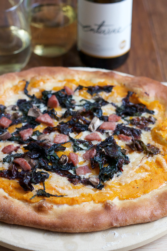 Roasted Butternut Squash Pizza with Sautéed Swiss Chard, cooked with entwine Chardonnay wine, and topped with sausage, cremini mushrooms and fontina cheese. Savory pizza doesn't get any better than this! #ad