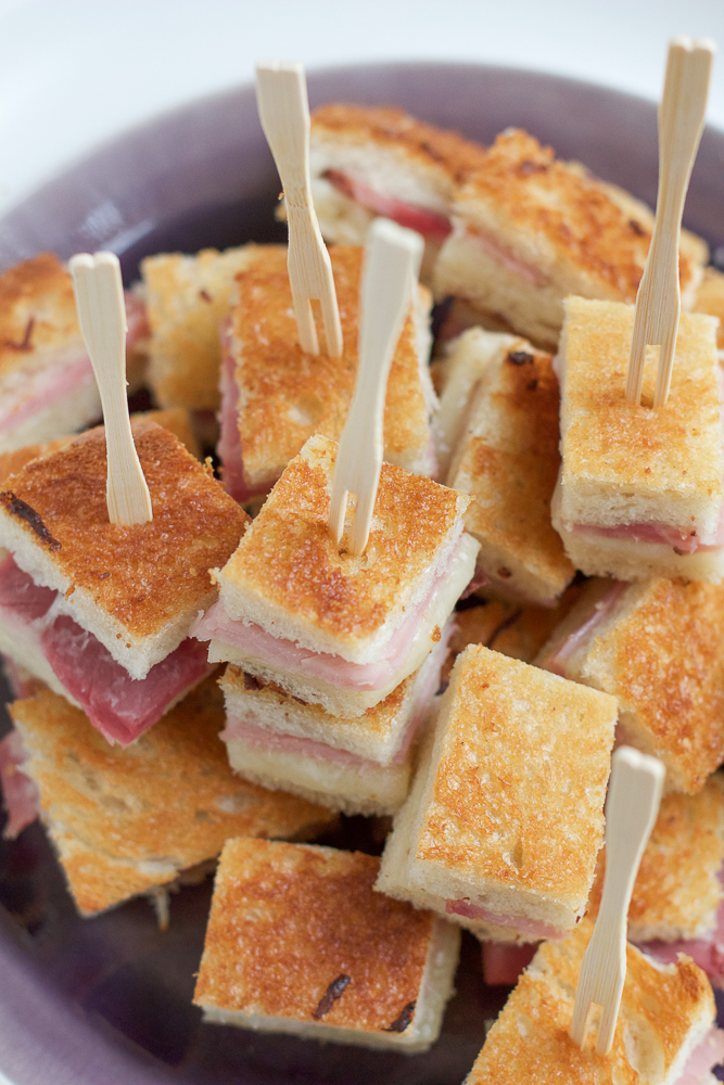 Mini BAKED Croque Monsieur Sandwiches.. a traditional French ham and cheese sandwich, made in bite sized form! The easiest and tastiest appetizer ever!