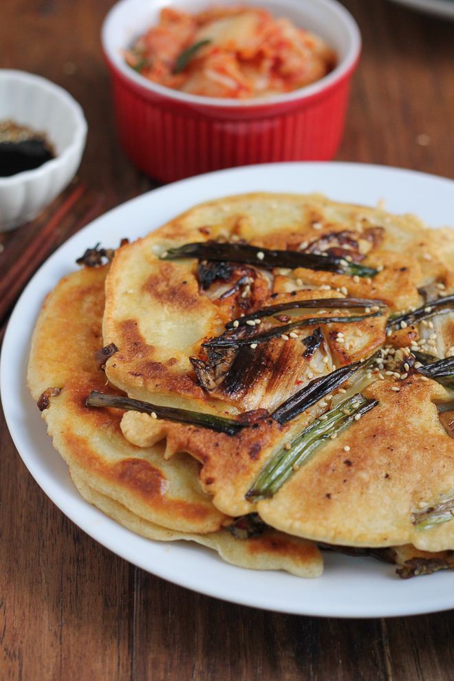 Savory Korean Kimchi Scallion Pancakes! Packed with scallions, mushrooms and kimchi, these pancakes are so delicious and easy to make! They serve as a great appetizer, side dish or snack! #spon