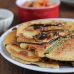 Korean Kimchi Scallion Pancakes! Packed with scallions, mushrooms and kimchi, these pancakes are delicious and easy to make!