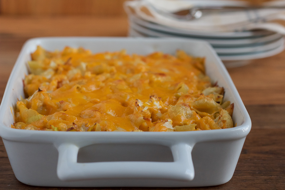 Spicy Cauliflower Mac and Cheese! Loaded with three different cheeses, leeks and seasoned, roasted cauliflower, this baked mac and cheese is a cheese lover's dream!