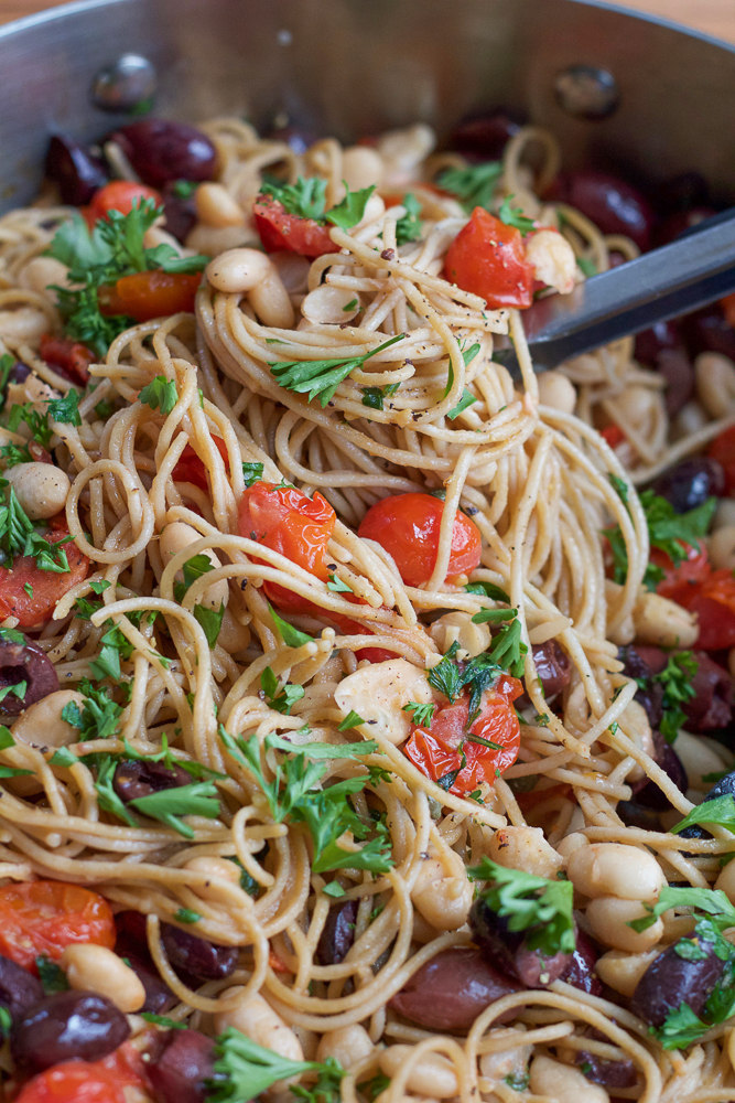 30-minute Whole Grain Pasta with White Beans and Tomatoes. A gorgeous and delicious meal that comes together quickly and easily. It's so simple, yet so rich in flavor, you'll be making this time and time again.