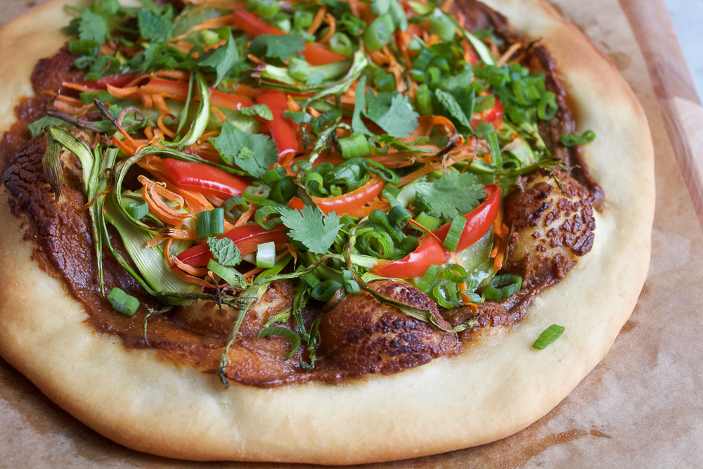 Vegan Asian Spring Roll Pizza! Everything fresh and delicious you love about Asian Spring Rolls. . on a pizza! And the spicy peanut sauce has amazing flavor that ties everything together! You will love this pizza!